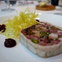 Pork and foie gras terrine with pickled cherry and frisee