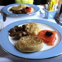 Crumpets with smoked salmon, scrambled eggs, mushrooms and caviar