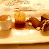Assiette of Chocolate including white chocolate vanilla cream, dark chocolate sorbet and a macaroon with caramel glaze