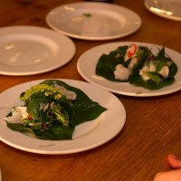 Bai cha plu pla dip - citrus cured brill with som saa and kaffir lime on betel leaf from som saa