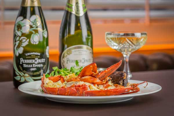 Enjoy 50% off the new surf and turf dinner at the Grill at McQueen
