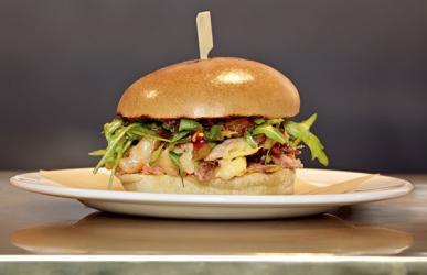 Peter Gordon launches a new menu with a duck confit burger at Gourmet Burger Kitchen