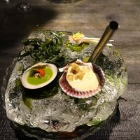A hunk of ice with seafood and lemongrass infusion
