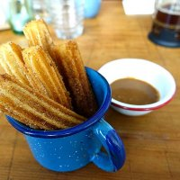 Traditional churros - coated in brown sugar and cinnamon. With Dulce de Leche for dipping