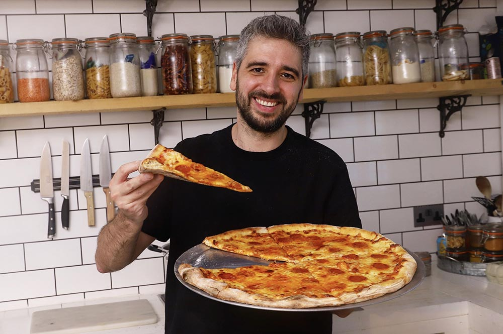 Miguel's Pizza offers pizza by the slice from One Pound Meal's Miguel Barclay