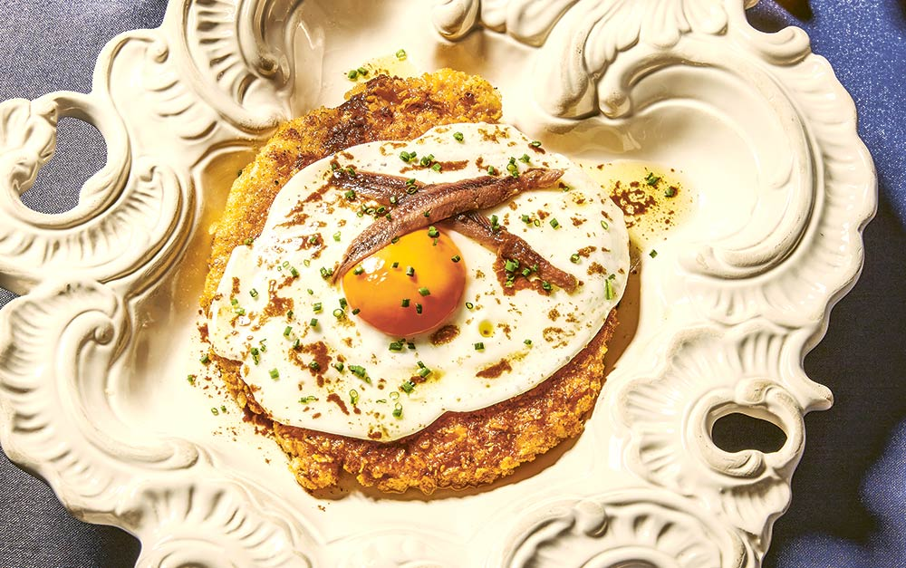 Carl Clarke recipe - Doritos-coated schnitzel with fried eggs and anchovies